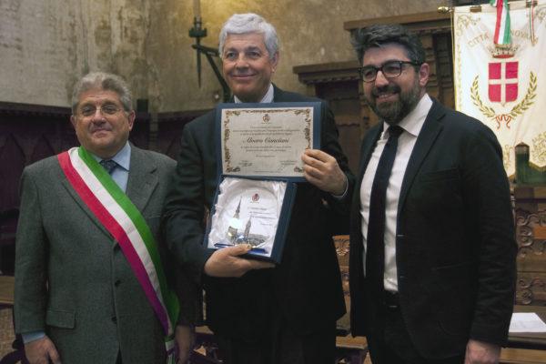 Alvaro Canciani, premiato da Sante Bongo e Perugini
